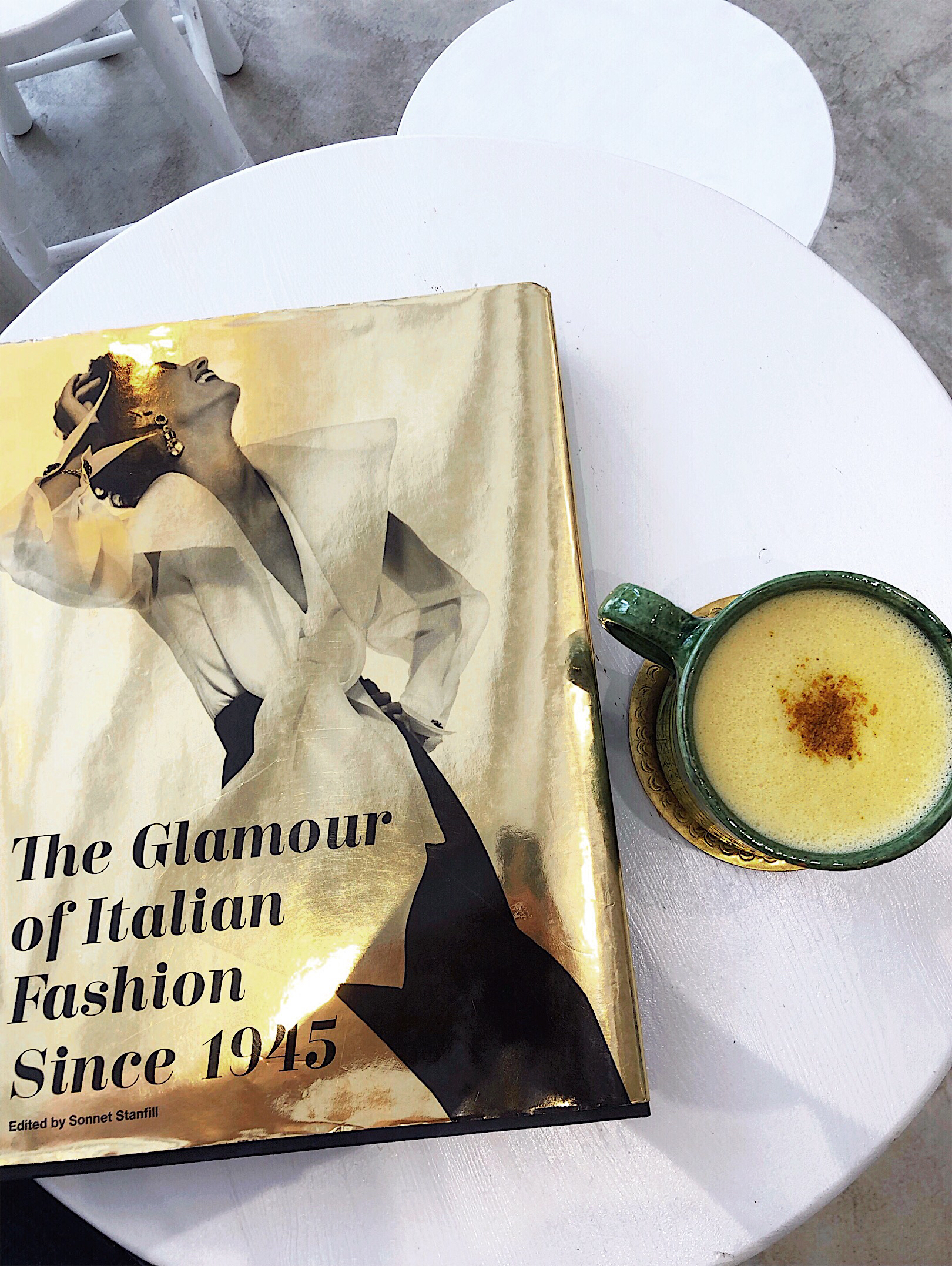The Glamour of Italian Fashion book on the table